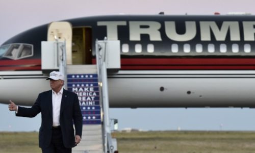 Republican presidential nominee Donald Trump walks across the tarmac as he arrives for a rally at the JetCenters of Colorado in Colorado Springs, Colorado on September 17, 2016. / AFP / Mandel Ngan        (Photo credit should read MANDEL NGAN/AFP/Getty Images)